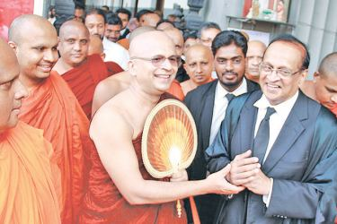 Ven. Uduwe Dhammaloka Thera with his lawyers after the verdict. Picture by Dushmantha Mayadunne