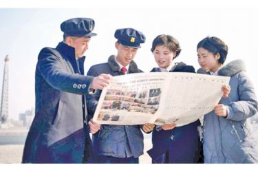 North Korean students in Pyongyang read the newspaper coverage of Kim Jong Un's summit with US President Donald Trump.