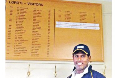 Angelo Mathews poses for a photo in front of the Lord's Honours Board during Sri Lanka's 2014 tour of England. Sri Lanka captain Mathews scored a Test century at Lord's in the first Test against England, which helped him join many Sri Lankan greats before him on the Honours Board.