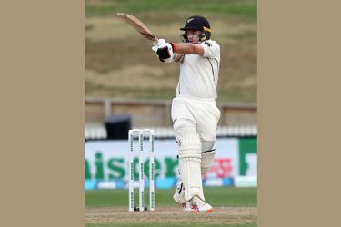New Zealand's Tom Latham plays a shot during day two of the first cricket Test match against Bangladesh at Seddon Park in Hamilton on Friday. AFP