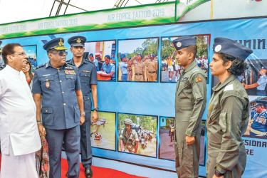 President Maithripala Sirisena and Air Force Commander Air Marshal Kapila Jayampathy at the SLAF's Air Tattoo and Exhibition to mark its 68th anniversary on Saturday. Picture courtesy President's Media Division