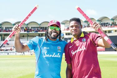 Man of the Series Chris Gayle and Man of the Match Oshane Thomas celebrate Windies victory at the Darren Sammy Cricket Ground, St Lucia's on Saturday.