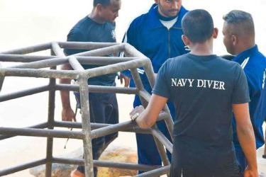 Sri Lankan Navy Divers planning the setting up of the steel structures in the Sea.