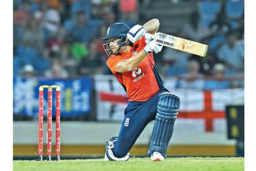 Jonny Bairstow of England hits a four during a T20 match against West Indies at Darren Sammy Cricket Ground in Gros Islet, Saint Lucia on Tuesday. – AFP