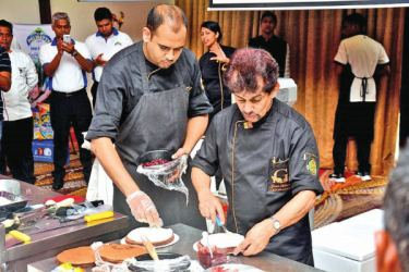 Chef's Guild Lanka Chairman Gerard Mendis using Pelwatte products in the cookery demonstration
