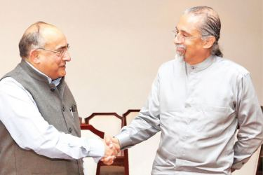 India's Film Certification Appellate Tribunal Chairman, former  Judge Manmohan Sarin and Public Performance Board of Sri Lanka Chairman  and Additional Secretary to the Prime Minister Saman Athaudahetti at the meeting.