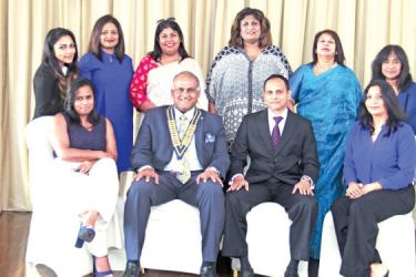 The female members of The Rotary Club of Colombo Mid City with the District Governor for Sri Lanka, Dushan Soza and District Secretary Chrishantha Herath