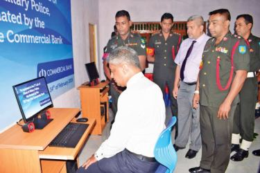 Commercial Bank's Regional Manager North Central Michael de Silva, Lieutenant Colonel H.M.S.I. Senarath and Mahesh Ratnayake of the Bank's CSR Unit at the IT Lab presented by the Bank to the SLCMP.