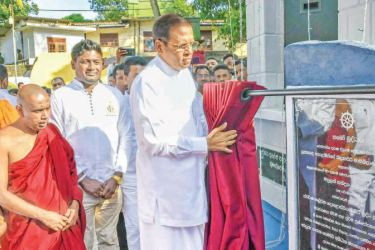 President Maithripala Sirisena unveils the memorial plaque at the Purana Divurum Bodhimalu Viharaya in Ampitiya.  Picture by Indika Polkotuwa