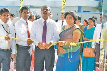 Bank of Ceylon's Deputy General Manager Sales and Channel Management, C. Amarasinghe, Assistant General Manager Western Province North- Priyal Silva and other bank officials, at the opening