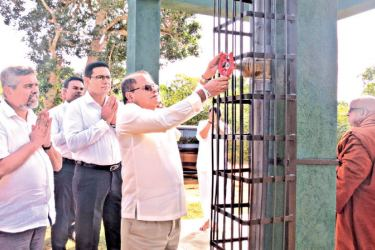 Commercial Bank Chairman Dharma Dheerasinghe commissions the water tank presented by the Bank to the monastery in the presence of the monks, the Bank's Chief Operating Officer Sanath Manatunge and representatives of the Bank.