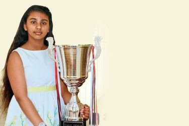 With the trophy she won at the Child Genius contest