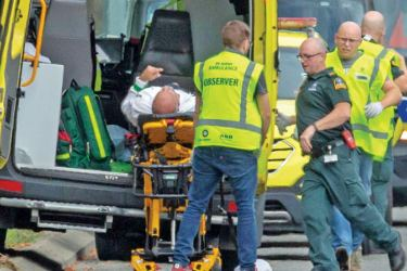An injured person is loaded into an ambulance following a shooting at the Al Noor Mosque in Christchurch, New Zealand, on Friday. - AFP