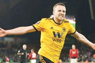 Wolverhampton Wanderers' Diogo Jota celebrates scoring their second goal against Manchester United in their FA Cup quarterfinal on Saturday.
