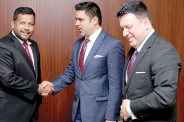 Afghanistan's Ambassador M. Ashraf Haidari (centre) greets Sri Lanka Minister of Industry and Commerce Rishad Bathiudeen (left) joined by Afghanistan Charge d'Affaires to Sri Lanka, Munir Ghiasy.