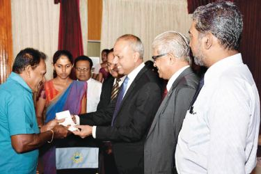 An employee is being awarded with  a gold medal by  Minister of Ports and Shipping and Southern Development, Sagala Ratnayaka, Kavan Ratnayaka Chairman of SLPA, Captain Athula Hewawitharana  Managing Director, P. Ranathunga Director (Human Resources) and Nirmal Fonseka Chief Manager (Human Resources) are also present in the  picture.