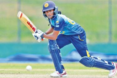 Sri Lanka Women's Harshitha Madavi who top scored for her side with 42 scores runs on the off side in the second ODI against England Women at Hambantota on Monday.