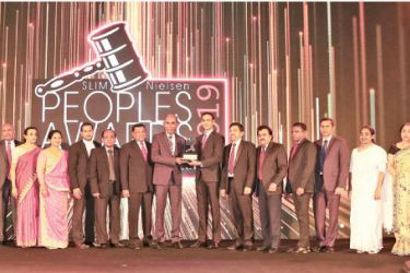 "Chief Executive Officer/General Manager Designate.  Rasitha Gunawardana of People's Bank receives the 'People's Service Brand of the Year"" at the awards ceremony."
