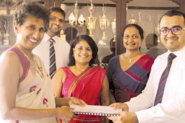 Ladies' College Principal Eesha Speldewinde  and Headstart CEO Hasitha Dela exchange the agreement in the presence of Senal Welaratne, Associate Business Analyst at Headstart, Deepika Dassanaike, Vice Principal of Ladies' College and  Madhavi Amarasinghe, Consultant.