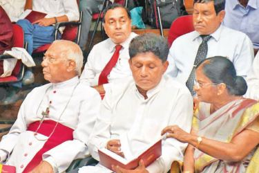 Prof. Rohini Paranavitana explains details of the new edition of the Sinhala dictionary to Minister Sajith Premadasa. Colombo University Vice Chancellor  Bishop Oswald Gomis is also present. Picture by Gayan Pushpika