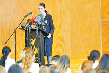 New Zealand's Prime Minister Jacinda Ardern, speaks to students during a high school visit in Christchurch, New Zealand on Wednesday.
