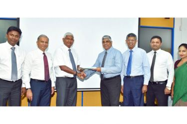 Ceylinco Healthcare Services Limited (CHSL) Chairman R. Renganathan  with National Insurance Trust Fund (NITF) CEO Sanath De Silva exchange the agreement in the presence of the senior representatives of the two institutions.