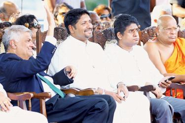 Prime Minister Ranil Wickremesinghe greeting onlookers at the D.S. Senanayake commemoration ceremony held at the Independence Square yesterday. State Defence and Media Minister Ruwan Wijewardene, MP Vasantha Senanayake and Ven. Thiniyawela Palitha Thera look on. Speaker Karu Jayasuriya also participated. Picture by Hirantha Gunathilake