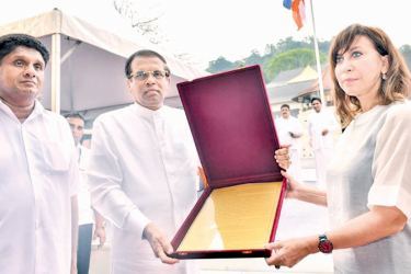 President Maithripala Sirisena handing over a request to UN Resident Coordinator Hanaa Singer seeking World Heritage recognition to the 'Tripitaka' - the sacred canon of Theravada Buddhism, written in Pali, at the Dalada Maligawa premises in the presence of Minister Sajith Premadasa.