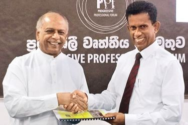 PPF Chief Organiser and Coordinator Gamini Gunasekara handing the PPF policy papers to MP Gunawardena.