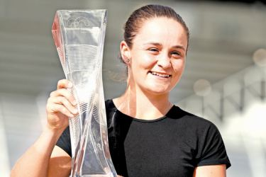 Ashleigh Barty of Australia poses with the winner's trophy after defeating Karolina Pliskova of the Czech Republic in the Women's final on day 13 of the Miami Open at Hard Rock Stadium on Saturday. – AFP