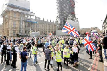 Pro-Brexit protesters wearing yellow vests, the symbol of the anti-government movement in France, gather in London on Saturday.