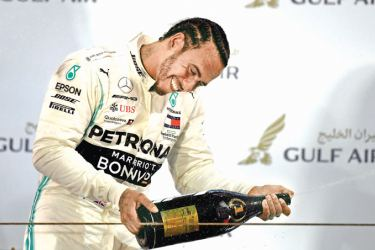 Mercedes' British driver Lewis Hamilton (C) celebrates on the podium after winning the Formula One Bahrain Grand Prix at the Sakhir circuit in the desert south of the Bahraini capital Manama, on March 31, 2019. AFP