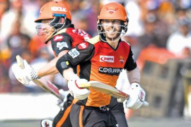 Sunrisers Hyderabad cricketers Jonny Bairstow (L) and David Warner run between the wickets during the 2019 Indian Premier League (IPL) Twenty20 cricket match against Sunrisers Hyderabad on Sunday. - AFP