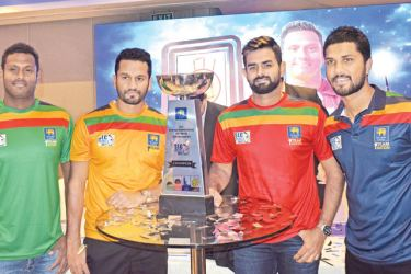 The four captains of the Super Provincial limited-over tournament (from left): Angelo Mathews (captain Team Dambulla), Dimuth Karunaratne (captain Team Kandy), Lahiru Thirimanne (acting captain Team Galle) and Dinesh Chandimal (captain Team Colombo) with the Trophy that will be awarded to the winners. Pic by Herbert Perera