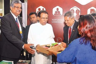 President Maithripala Sirisena yesterday inaugurated the Innovate Sri Lanka 2019 exhibition to mark the 60th anniversary of the Jayawardenapura University, at the BMICH premises. Picture shows the President and University Vice Chancellor Professor Sampath Amaratunga at a exhibition stall. picture by Sulochana Gamage