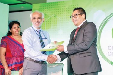 Sinclair Cruse, Head of Business - Reckitt Benckiser handing over the partnership agreement with MEPA for the Dettol 'Clean Hands, Clean Nation' initiative to Rear Admiral (Retd) Rohana Perera, Chairman of MEPA