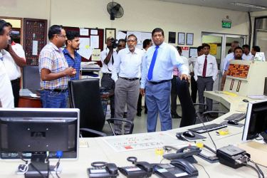 Power, Energy and Business Development Minister Ravi Karunanayake at the Kelanitissa power plant yesterday.