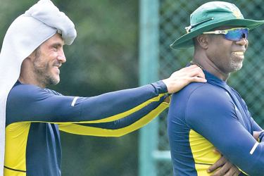 South Africa's captain Faf du Plessis (R) and team coach Ottis Gibson.