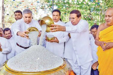 President Maithripala Sirisena and Prime Minister Ranil Wickremesinghe filling a large receptacle with rice at the Aluth Sahal Mangalyaya held at the Jaya Sri Maha Bodhi premises in Anuradhapura. Picture courtesy President's Media Division