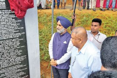 Finance Minister Mangala Samaraweera and Indian High Commissioner Taranjit Singh Sandhu, at the ceremony at Indola Estate in Matara, on Saturday.
