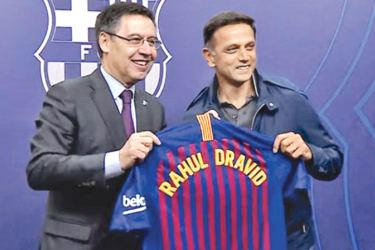 Test great Rahul Dravid attended the marquee La Liga clash between FC Barcelona and Atletico Madrid at the Camp Nou on Sunday.