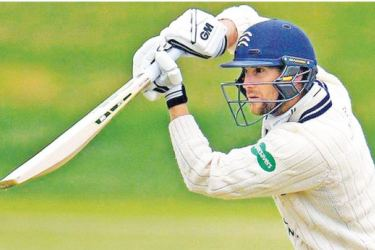Dawid Malan led a Middlesex recovery with an unbeaten half century.