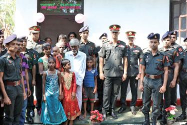 Jaffna troops with a beneficiary family.