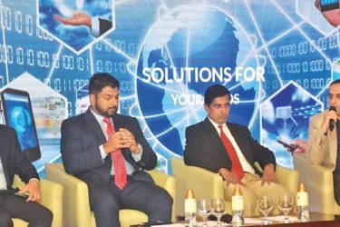 Dinakar Tadepalli, Practice Head for Unified Communications and Collaboration for Avaya India & SAARC (extreme right) at the Customer Panel Discussion along with (L to R) Kuntal Shah - Director Sales Engineering for Avaya India & SAARC, Sanjeeva Aeygoonawardena - Executive Director, Mountain Hawk Express Pvt Ltd at FedEx Express and Prasad Keerthiratne - Head of IT, Lanka Tiles Group of Companies