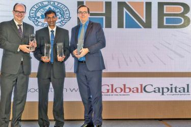 Janath Ilangantileke, Assistant General Manager, Trade and Financial Institutions, HNB accepting the awards