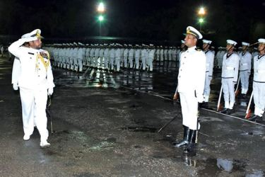 North-central Naval Area Commander Rear Admiral Muditha Gamage saluting the recruits.