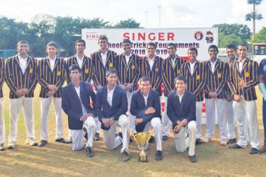 Victorious Royal College U-19 team with the trophy