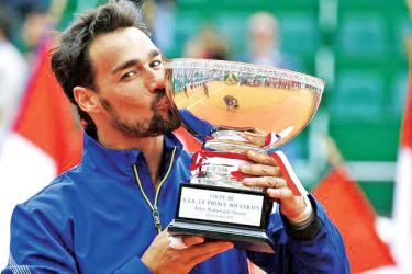 Italy's Fabio Fognini celebrates with the trophy after winning the final against Serbia's Dusan Lajovic.