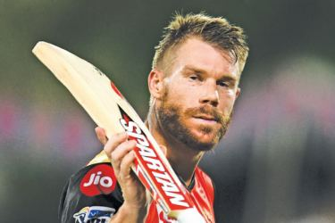 Sunrisers Hyderabad cricketer David Warner gestures as he walks back to the pavilion during the 2019 Indian Premier League (IPL) Twenty20 cricket match against Kolkata Knight Riders at the Rajiv Gandhi International Cricket Stadium, Hyderabad on Sunday. - AFP