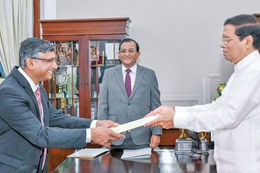 Additional Auditor General Chulantha Wickramaratne receiving his appointment letter as the new Auditor General from President Maithripala Sirisena at the Presidential Secretariat yesterday morning. Picture courtesy President's Media Unit